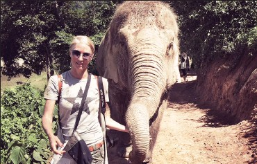 ??  ?? ANIMALS: The writer Allison Foat walking with elephants at the Elephant Nature Park sanctuary in Chiang Mai, Thailand – an ethical alternative to riding these gentle creatures.