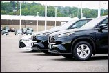 ?? Englewood, Colorado. (AP) ?? In this file photo, a pair of unsold 2021 Highlander sports utility vehicles and a Camry sedan are parked on the empty storage lot outside a Toyota dealership in