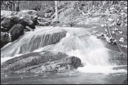 ?? DAN COLLINS ?? Dan Collins photographed thiswaterfall along a hiking trail in Montreat, N.C. The pandemic presented his family a chance to travel that might not come around again.
