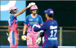 ?? PTI ?? Rajasthan Royals players celebrate their win in the Indian Premier League cricket match against Delhi Capitals at the Wankhede Stadium in Mumbai, Thursday