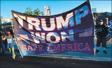 """?? Brendan Smialowski AFP/Getty Images ?? """"DOES ANYBODY really believe the California recall election isn't rigged?"""" former President Trump said Monday. Above, Trump supporters gather on President Biden's motorcade route through Long Beach."""