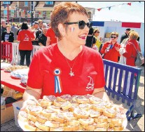 """?? WENDY ROSE PHOTO ?? After the large offering of """"vin d'honneur"""" was depleted, volunteers began handing out snacks comprised of local breads and charcuterie."""
