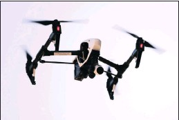 ??  ?? A drone operated by DroneLinx captures videos and still images of an apartment building in Philadelphia, US. DroneLinx has a variety of clients who want aerial photos or videos but don't want or need their own aircraft.