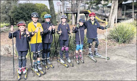 ??  ?? A DIFFERENT APPROACH: Tawonga Primary School students (from left) Charlotte Ryder, Jai Redmond, Grace Shaban, Emily Macklan, Eddy Franzke and Rock McLean enjoyed learning to ski despite not being able to go to the snow.