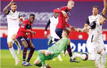 ?? Reuters ?? ↑ Players of Lille and Montpellier in action during their French League match on Friday.