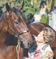 ??  ?? IN FORM: Trainer Helen Page with her star Rudy.