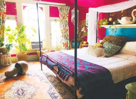 """?? AUGUSTA WHEELER ?? After contracting covid-19, cluttercore adherent Augusta Wheeler of Atlanta confined herself to her bedroom, where she was surrounded by sentimental decor. """"My grandmother's curtains were in there,"""" she says. """"That's comforting."""""""