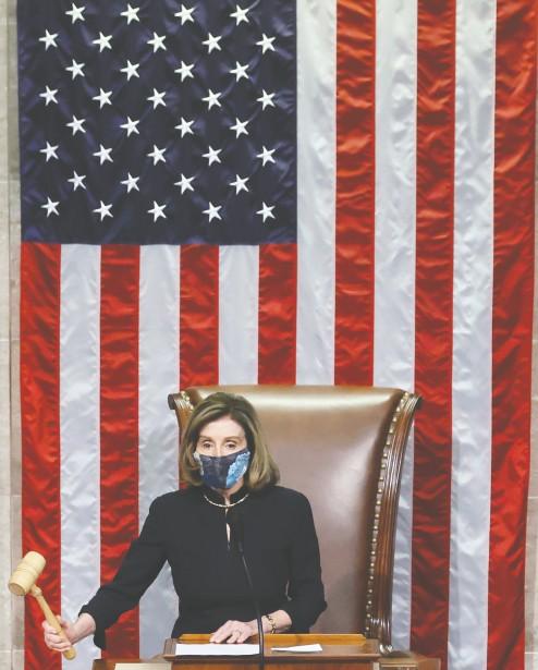 ?? Jonathan Ernst / REUTERS ?? U.S. House Speaker Nancy Pelosi presides over the vote to impeach President Donald Trump on Wednesday.