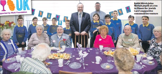 ?? PHOTO: MARC MORRIS ?? Rabbi Mirvis joins Moriah pupils at a tea in Pinner for Jewish Care's supportive communities venture