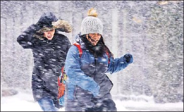 ?? Carolyn Cole Los Angeles Times ?? NEW YORK GOV. Andrew Cuomo banned all travel in the nation's largest city; even trains and large segments of New York City's subway system were shut down. Here, two women cross 6th Avenue in Manhattan.
