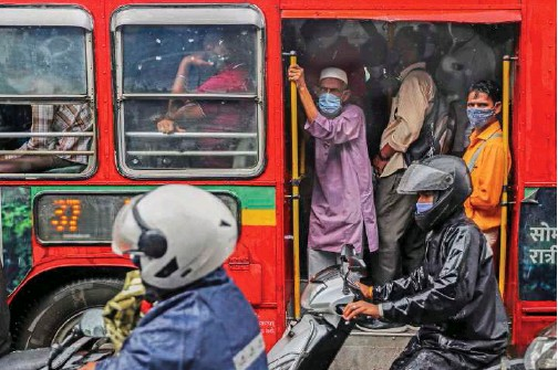 ?? File/associated Press ?? People, wearing masks as a precaution against coronavirus, travel in a bus in Mumbai, India.