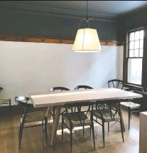 ??  ?? In some rooms with high ceilings, painting the ceiling a dark colour can create the illusion of a cosier, warmer space.