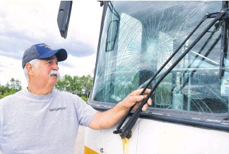 ?? SHARON MONTGOMERY-DUPE • CAPE BRETON POST ?? Gary Pozzebon, president of the Cape Breton Drag Racing Association, looks at some of the damage recently caused to their bus at their racetrack off Grand Lake Road in Sydney, used for many purposes including providing tickets for spectators.