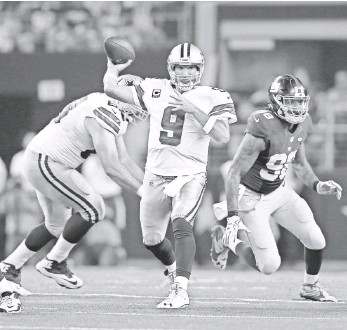?? MATTHEW EMMONS, USA TODAY SPORTS ?? Tony Romo, 2014's top-rated passer, led the Cowboys to a season-opening comeback win Sunday.