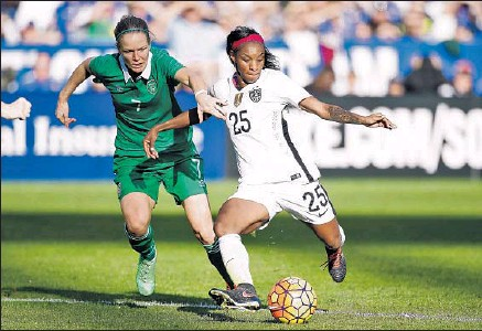 ?? Todd Warshaw Getty Images ?? CRYSTAL DUNN, right, getting to the ball ahead of Ireland's Diane Caldwell, says she has grown as a person and a player.