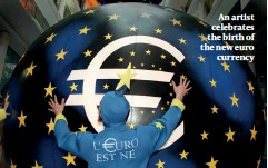 ??  ?? An artist celebrates the birth of the new euro currency