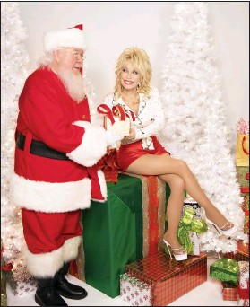 """?? PHOTO COURTESY OF STACIE HUCKEBA ?? Dolly Parton released a new Chrsitmas album, """"A Holly Dolly Christmas"""" on Butterfly/ 12 Tone Music, which includes five Parton-penned songs and duets with Willie Nelson, Michael Buble, Billy Ray and Miley Cyrus."""