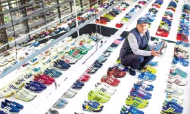??  ?? Designer Gary Aspden prepares the Adidas exhibition at the Blackburn Corn Exchange. Photograph: Joel Goodman/The Guardian