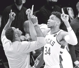 ?? KATHY WILLENS/ASSOCIATED PRESS ?? Giannis Antetokounmpo, right, and the Bucks have been outplayed by the Nets in the first two games.