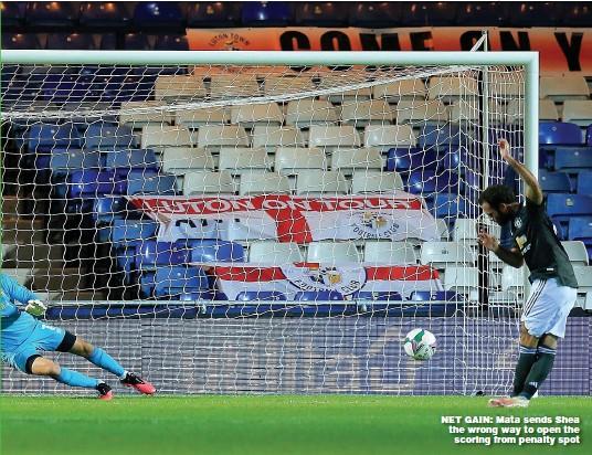 ??  ?? NET GAIN: Mata sends Shea the wrong way to open the scoring from penalty spot