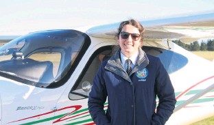 ?? PHOTO: GUS PATTERSON ?? Flying high . . . New Zealand Airline Academy instructor Ellie McIlraith is right at home in the Tecnum P208.