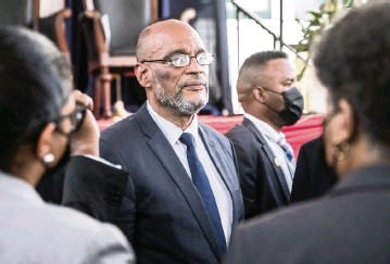 ?? VALERIE BAERISWYL AFP via Getty Images, 2021 ?? Prime Minister Ariel Henry told a prosecutor that he had been fired due to 'serious administrative infractions.'