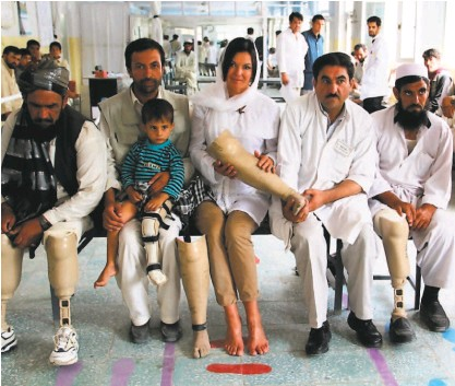 """?? Courtesy Heidi Kuhn ?? Heidi Kühn, author of """"Breaking Ground,"""" meets with landmine survivors at a Red Cross clinic in Kabul. Kühn is a former CNN journalist and a fifthgeneration Marin County resident."""