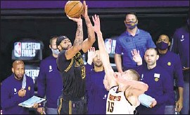 ?? Mark J. Terrill Associated Press ?? AFTER ANTHONY DAVIS hit this winning shot in the playoffs last season against Denver, James said he wished it could have happened at Staples Center.