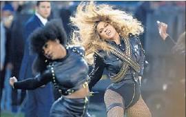 ?? Matt Slocum AP ?? BEYONCÉ lets her hair down at Super Bowl halftime show in Santa Clara, Calif.