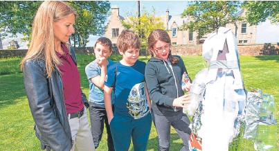 """??  ?? Former NASA Astronaught Rick Hieb, top right, and NASA Dr Sue Lederer visit pupils from Fife Primary Schools who have almost completed a """"Space School"""". The pupils learned about the science and processes relating to space while on a visit to St Andrews..."""