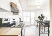 ??  ?? Kitchens have a contemporary esthetic, featuring quartz countertops and luxury vinyl flooring.