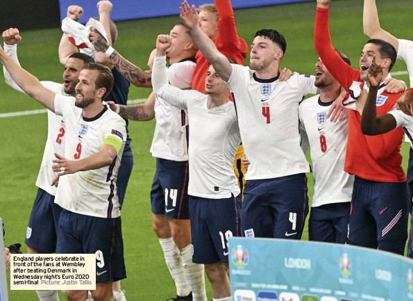 ?? Picture: Justin Tallis ?? England players celebrate in front of the fans at Wembley after beating Denmark in Wednesday night's Euro 2020 semi-final