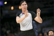 ?? NICK WASS — THE ASSOCIATED PRESS ?? Referee Natalie Sago gestures during the first half of an NBA basketball game between the Washington Wizards and the Detroit Pistons in Washington, in this Monday, Nov. 4, 2019, file photo. With more female referees now in the NBA than ever before, it was only a matter of time before two women would be scheduled to work the same game. And Monday, Jan. 25, 2021, became that day. Natalie Sago and Jenna Schroeder made up two-thirds of the crew assigned to the Charlotte at Orlando game, the first time in NBA history that two women would be working a regularsea­son contest together.