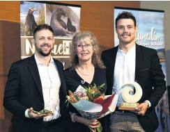 ?? PHOTO: GREGOR RICHARDSON ?? For the love of frogs . . . The family of the late Prof Phil Bishop, Wild Dunedin's Wild Hero for 2021, wife Debbie Bishop and sons Adam (left) and Luke, accept his award at the Otago Museum during Wild Dunedin's opening night celebrations on Earth Day.