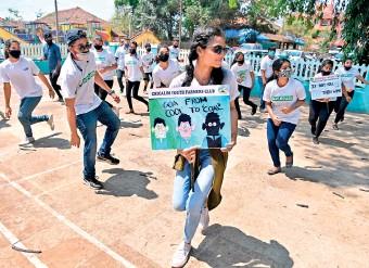 ??  ?? young environmental activist Neola Sybil Pereira (C) dances with other activists during a flashmob at Altona in Goa. AFP