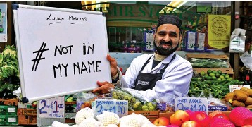 ??  ?? Speaking out: A shop worker in Luton joins a Twitter campaign in the town yesterday