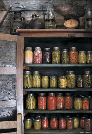 ?? © GETTY IMAGES ?? Right: The shelves in this old wooden cabinet were spaced to allow air to flow freely around the jars and prevent jars from being stacked on one another because minor quakes or bumps to the cabinets could send the jars crashing to the floor.