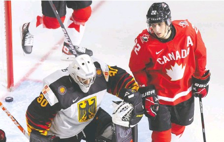 ?? CODIE MCLACHLAN/ GETTY IMAGES ?? Dylan Cozens, right, has been a pain in the side of opposing goalies, such as Germany's Jonas Gahr.