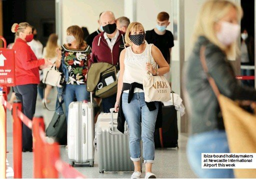 ??  ?? Ibiza-bound holidaymakers at Newcastle International Airport this week