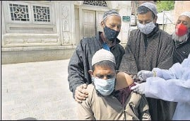 ?? WASEEM ANDRABI/HT PHOTO ?? A man receives a shot of a Covid-19 vaccine in Srinagar on Wednesday.