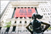 ??  ?? The 'Fearless Girl' bronze sculpture looks towards the New York Stock Exchange on Sept 10, in New York. Most everyone along Wall Street agrees that stocks are expensive following their amazing return to records despite the still-raging pandemic. (AP)
