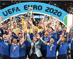 ??  ?? Italian players celebrating their Euro 2020 victory over England at Wembley… yesterday