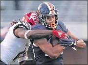 ?? ERIN EDGERTON/THE DAILY PROGRESS ?? Running back RonnieWalker had 22 yards on five carries in his first game with Virginia in Saturday's victory over Louisville. His first carrywent for 11 yards.