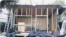 ??  ?? Constructing the walls, windows and doors on a garden office project.