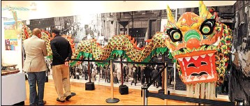 ?? RICHARD A. CHAP­MAN~SUN-TIMES ?? The grand re­open­ing of the Chi­nese-Amer­i­can Mu­seum of Chicago on Satur­day fea­tured dig­ni­taries, lion dancers and a rib­bon-cut­ting cer­e­mony.