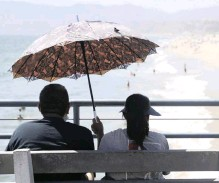 ?? | AP ?? A COUPLE sit on the pier during a heatwave in Santa Monica, California, in July. Like US President Donald Trump, many people hoped summer would bring an end to the spread of Covid-19, but the rising number of deaths has shown that the healing power of the sun has been no match for the novel coronavirus.