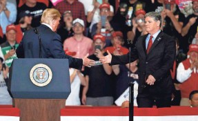 ?? JEFF ROBERSON/AP ?? President Donald Trump greets Fox News' Sean Hannity at a campaign rally in 2018, in Cape Girardeau, Mo.