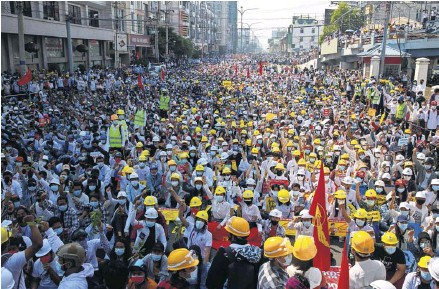 ?? PHOTOGRAPH: AFP/GETTY ?? A huge protest in Mandalay yesterday. Workers across the country, from railway staff to doctors, teachers and factory workers, went on strike over the coup and the arrest of Aung San Suu Kyi, below