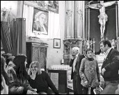 ?? SAMUEL ARANDA / THE NEW YORK TIMES ?? The Rev. Angel Garcia Rodriguez, center in suit, at San Anton church in Madrid, Spain. Last year, he took over the abandoned church and reshaped it into something akin to a community center.