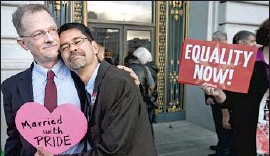 ?? Noah Berger Associated Press ?? A COUPLE embrace in 2013 after a Supreme Court ruling cleared the way for same-sex marriages in California. In 2015, such unions became legal nationwide.